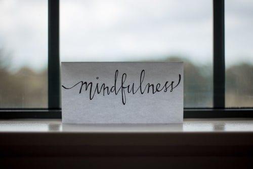 mindfulness-written-in-cursive-on-paper-near-window